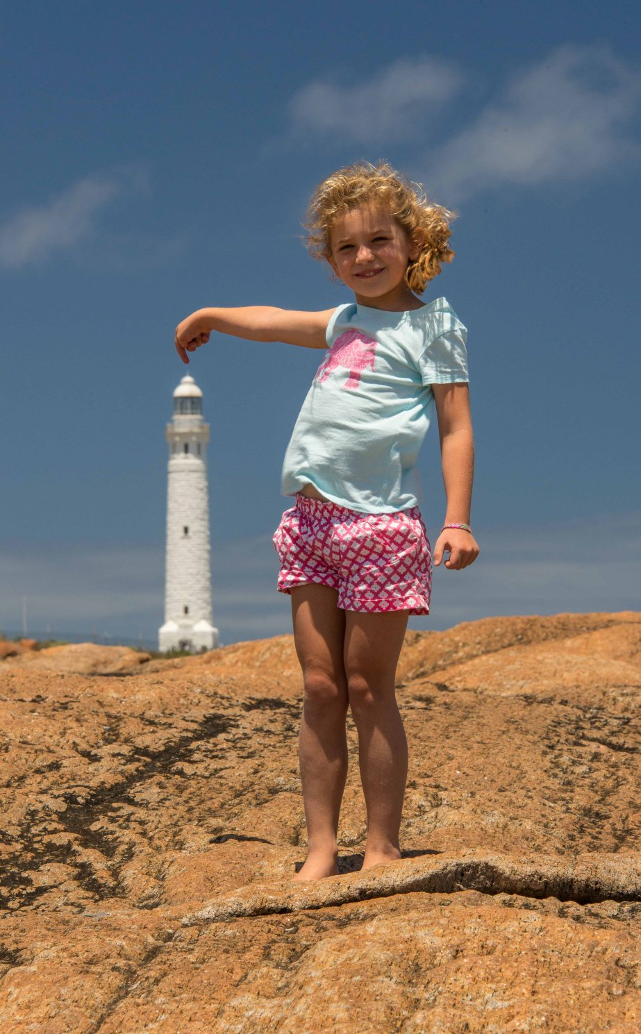 14-1 maddy holding tip of lighthouse